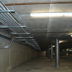 Interior of parking garage with ceiling lights