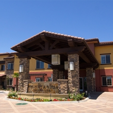 Entrance of senior living facility on a clear day